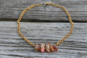 Gold necklace with red stones
