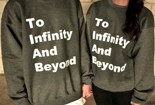 "matching sweaters say ""to infinity and beyond"""