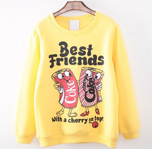 "Sweater. Coke and Cherry Coke cans with hands around shoulders. ""Best Friends With A Cherry On Top."""