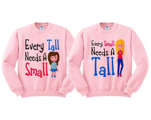 "matching sweaters. picture of short girl with ""every tall needs a small."" Picture of tall girl with ""every small needs a tall."""