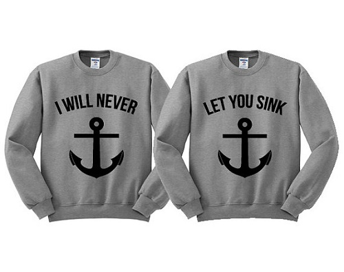 "matching sweaters with anchor say ""I will never"" and ""let you sink"""