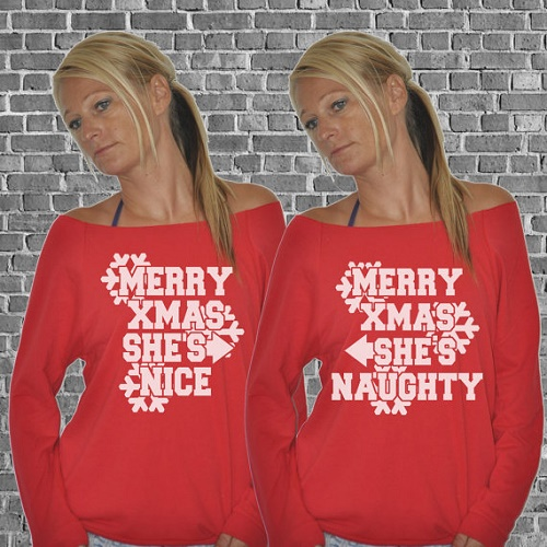"Matching sweaters. ""Merry Xmax, she's nice"" points to other sweater that says ""merry Xmas she's naughty"""