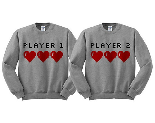 "Matching sweaters say ""player 1"" and ""player 2"""