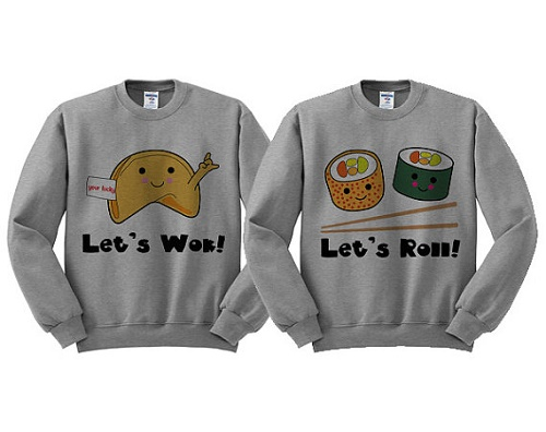 "matching sweaters: ""let's wok"" with picture of fortune cookie, and ""let's roll"" with picture of two sushi rolls"