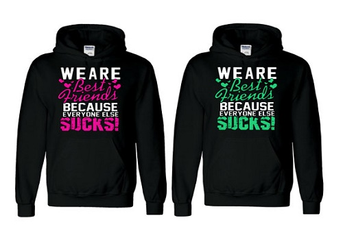 "Matching sweaters say ""We are best friends because everyone else sucks!"""