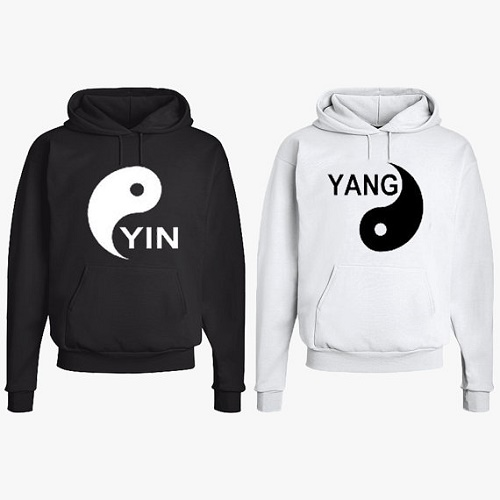 Matching sweaters one with Yin symbol, other with Yang symbol
