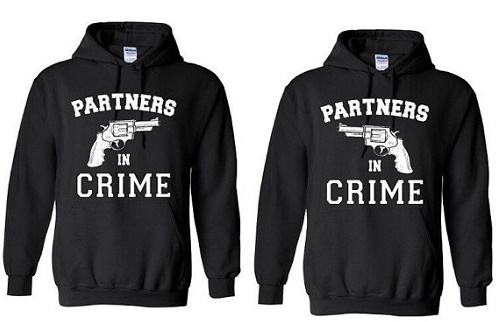 "Matching sweaters with handguns pointed at each other. ""Partners in crime.'"