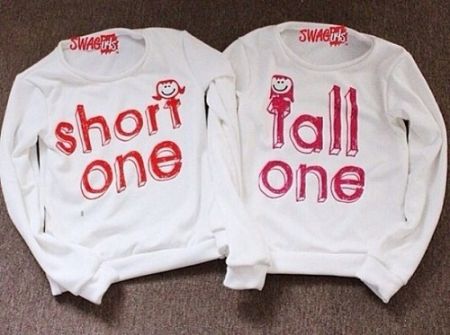 "matching sweaters labelled ""short one"" and ""tall one"""