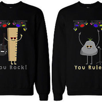 "matching sweaters. ""you rock!"" with picture of ruler, and ""you rule"" with picture of rock"